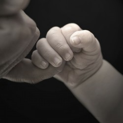 baby hand with parent